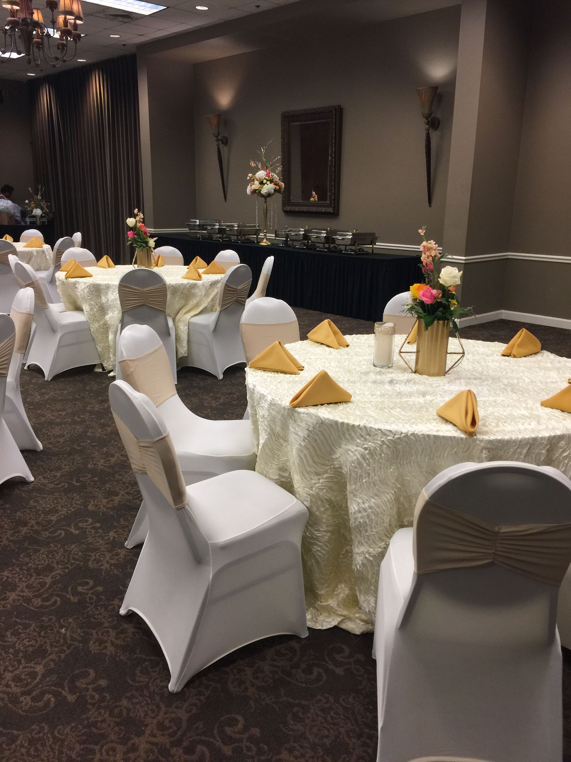 Tables and a buffet are set up for a reception