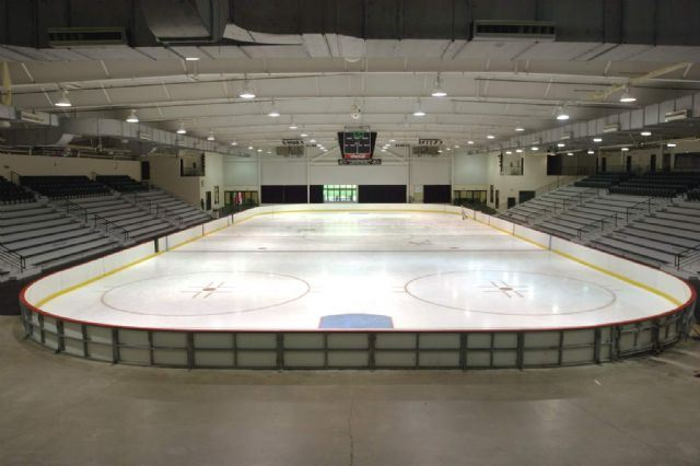 Empty ice rink with bleachers