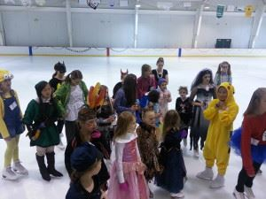 Children in costumes stand on the ice